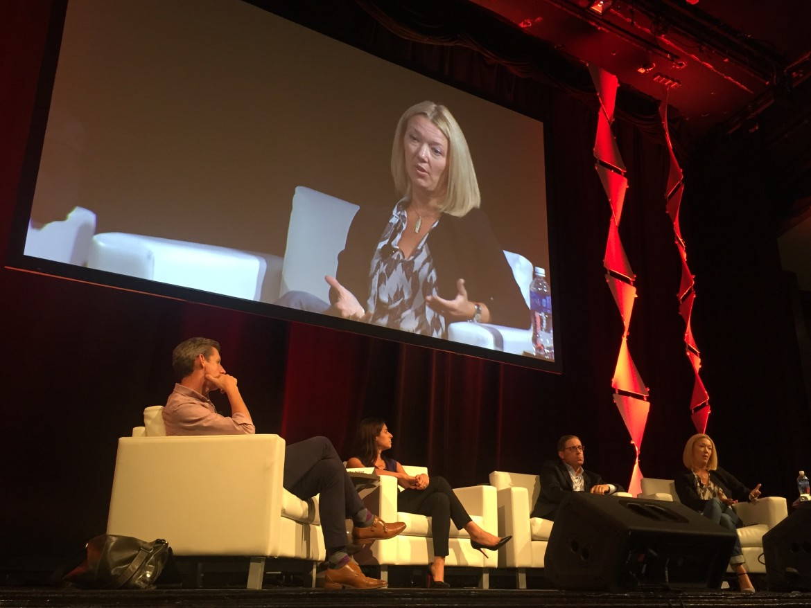 News Revenue Hub CEO Mary Walter-Brown speaks on stage at ONA